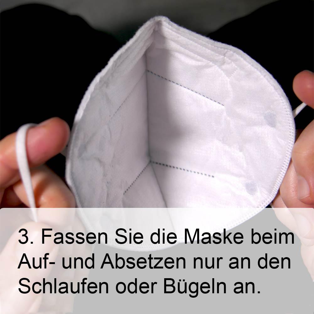 FFP2-Maske richtig aufsetzen Schritt 3: Beim aufsetzen die Schlaufen benutzen